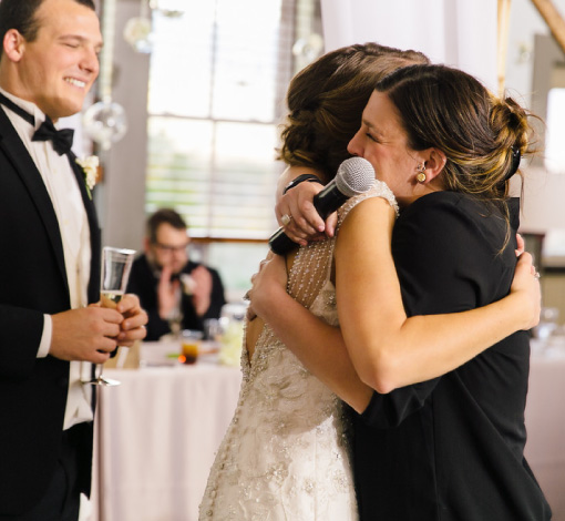 An Emily Weddings team member hugging a bride