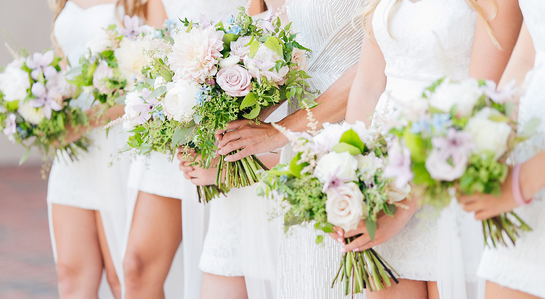 A close up shot of a bridal party's bouquets